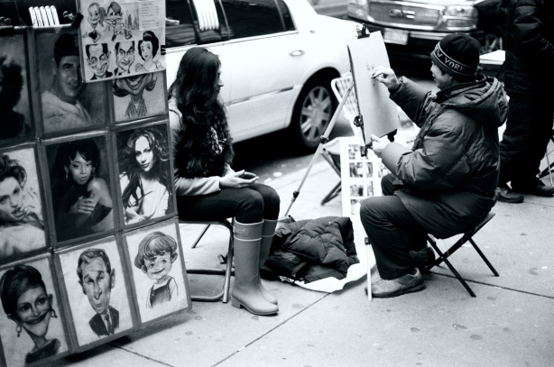 Street artist and a young girl