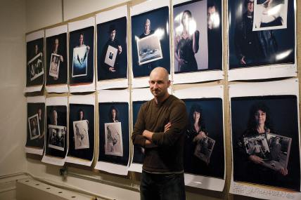 Photographer Tim Mantoani with 20x24 Polaroids in the NYC 20X24 Studio. Photo courtesy of Mantoani.com