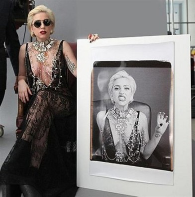 Lady Gaga with her 20x24 self portrait print. Photo courtesy of Vogue.com