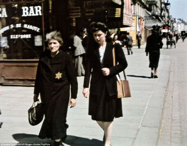 Two women walking about, one wearing the Jewish Star of David. Andre Zucca