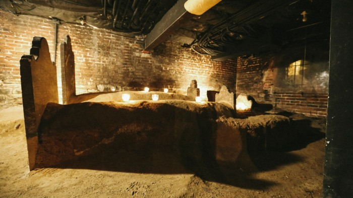 Baltimore, Md -- October 31, 2014 -- The family room of Elizabeth Gunn and William Robe in the catacombs at the Westminister Burying Ground.  (Kaitlin Newman/Baltimore Sun)