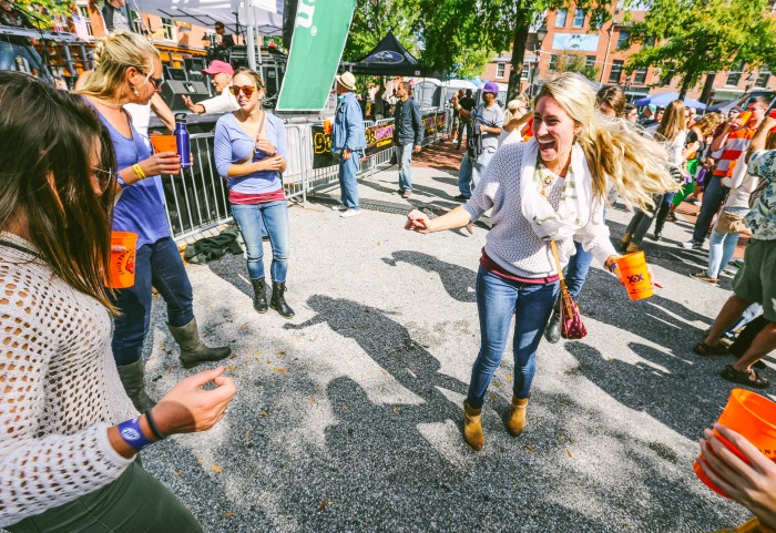Baltimore, MD -- October 4, 2014 -- Alison Bolinger, 26, dances with her friends at the Fells Point Festival. (Kaitlin Newman/Baltimore Sun)