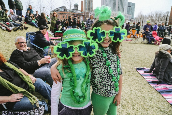 Baltimore, MD -- March 16, 2014 -- The third annual Shamrock Shindig took place at Pierce's Park on Pier V this past Sunday right before the Saint Patrick's Day Parade. Sisters Lyla, 5, and Lucinda, 7, Sheinin look stylish in some oversized shamrock sunglasses. (Kaitlin Newman/Baltimore Sun)