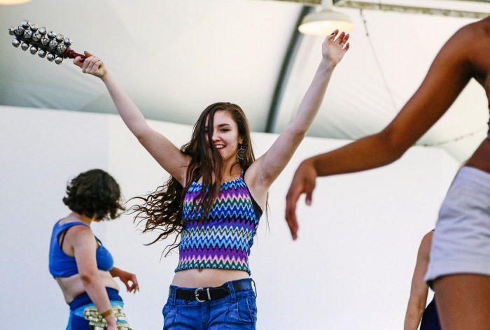 Cockeysville, MD -- June 7, 2014 --Alyssa Rhodes participates in a drum circle dance party at KarmaFest this past weekend at Oregon Ridge Park. (Kaitlin Newman/Baltimore Sun)