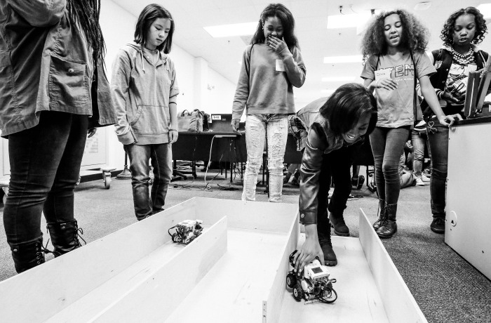 Annapolis, Md -- October 18, 2014 -- Students from North Bend Middle School attempt to manuver a mining robot through a maze at the Naval Academy's STEM event. (Kaitlin Newman/Baltimore Sun)
