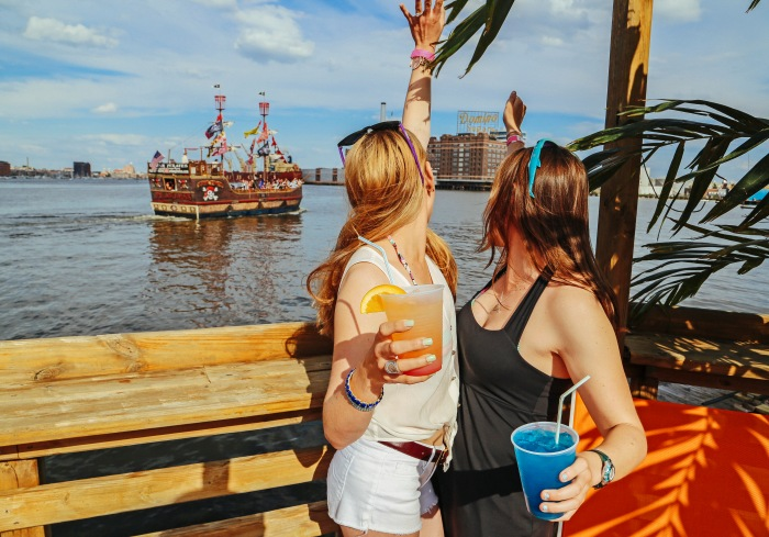 Baltimore, MD -- May 17, 2014 -- Melissa Morrissey, 26, with twin sister Elizabeth Morrissey celebrate Melissa's upcoming wedding at Tiki Barge. The tropical themed bar even has its own private pool overlooking one of the best views of the Baltimore skyline. (Kaitlin Newman/Baltimore Sun)