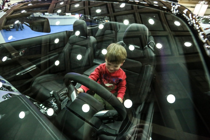 Baltimore, Md — January 4, 2015 — Nolan Gallagher, 2, gives the new 2015 Ford Mustang a spin at the Baltimore International Auto Show this past weekend. The MSRP was listed at $47,895.00 (Kaitlin Newman/Baltimore Sun)