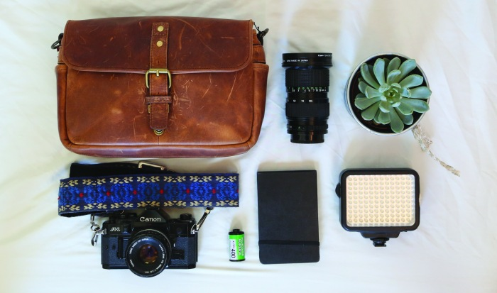 Camera bag flat lay, raw image, straight from the camera.