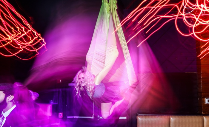 Baltimore, Md — February 14, 2015 — Brooke Sigwart, 27, wows the crowd with her aerial performance at Mosaic during the Mardi Gras celebration at Power Plant Live this past weekend. (Kaitlin Newman/Baltimore Sun)