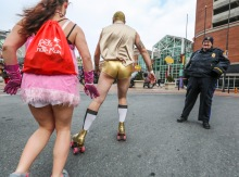 Baltimore, Md — February 14, 2015 — Dominic Heath, 30, skated his way around the Inner Harbor dressed as Goldfinger from Austin Powers during the Cupid's Undie Run this past Saturday. (Kaitlin Newman/Baltimore Sun)